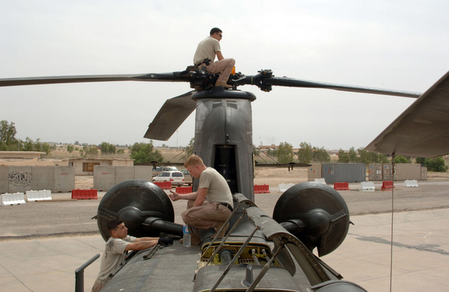 U.S. Army Soldiers, Bravo Company, 6th Battalion, 101st Command Aviation Brigade, 101st Airborne Division (Air Assault), perform pre-flight inspections on a CH-47 Chinook helicopter at Forward Operating Base Remagen, Tikrit, Salah ad Din Province, Iraq, on May 7, 2006, in support of Operation Iraqi Freedom.  (U.S. Army photo by SPEC. Teddy Wade) (Released)