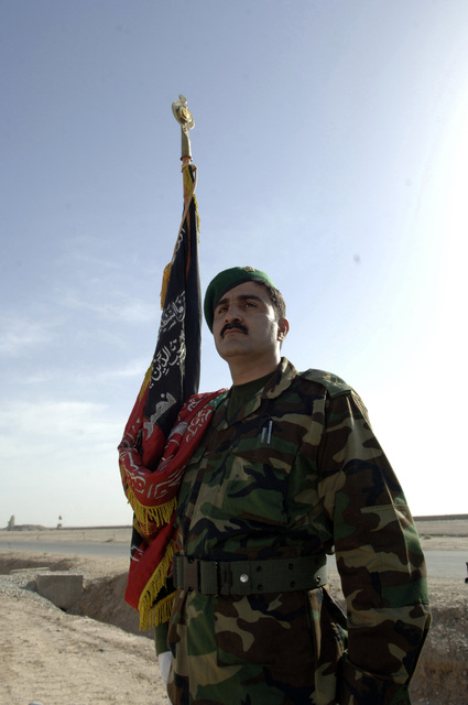 A member of the Afghan Military Police (AMP) color guard stands proud during the celebration of the Afghanistan flag rise at the new quarters of the 205th ANA Corps., Camp Shir Zai, Afghanistan, May 8, 2006. (U.S. Army PHOTO by Leslie Angulo)(Released)
