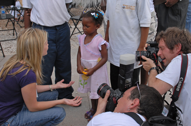 "[Hurricane Katrina] New Orleans, LA, 5-8-06 -- Academy Award Actress Reese Witherspoon talks with FEMA Trailer Park resident Tyle Conner about how she's doing during her visit as part of the ""Katrina Child Watch"" program, sponsored by the ""Children Defense Fund"".  Jennifer Garner is part of the Children's Defense Fund national celebrates visiting the area and the St. Roch FEMA Trailer Park to address the mental health, health, and education issues of children traumatized by Hurricane Katrina.  Marvin Nauman/FEMA photo"