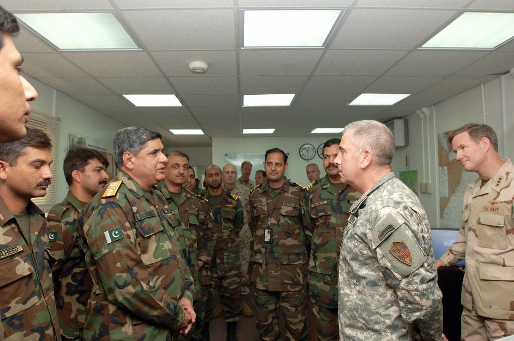 US Army (USA) General (GEN) John Abizaid (foreground right), Commander, US Central Command (USCENTCOM), talks with Bahrain Navy Rear Admiral (RADM) Shahid Iqbal, Commander, Combined Task Force 150 (CTF-150), and his staff at CTF-150 Headquarters at Naval Support Activity (NSA) Manama, Bahrain. USA GEN Abizaid is accompanied by USN Vice Admiral (VADM) Patrick Walsh (far right), Commander, USN 5th Fleet. CTF-150 conducts Maritime Security Operations (MSO) in the USCENTCOM Area of Operations