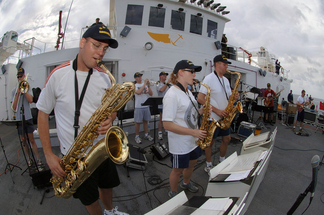 US Navy (USN) Musicians from the USN Show Band from Norfolk, Virginia (VA), performs for Sailors on the flight decks of the USN Military Sealift Command (MSC), Hospital Ship, USNS MERCY (T-AH 19). The USNS MERCY is currently underway in the Pacific Ocean, conducting a scheduled five-month deployment to deliver aid and humanitarian assistance to the Pacific Islands, and Southeast Asia.'''
