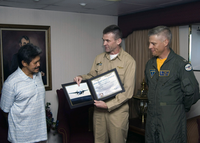 His Royal Highness, Prince Mohamed, Foreign Minister of Brunei, receives the title of Honorary Naval Aviator from the US Navy (USN) Nimitz-class aircraft carrier USS ABRAHAM LINCOLN (CVN 72), Commanding Officer (CO), Captain (CAPT) C. Andrew McCawley after landing aboard the ship for a tour in the Western Pacific.2006) - His Royal HighnessPrince MohamedForeign Minister of Bruneireceives the title of Honorary Naval Aviator from USS Abraham Lincoln s (CVN 72) Commanding OfficerCAPT. C. Andrew McCawley and Commander Air Group (CAG) CAPT. Matthew Klunder after landing onboard the USS Abraham Lincoln (CVN 72) for a tour of the ship by means of Carrier Onboard Delivery (COD) from Fleet...