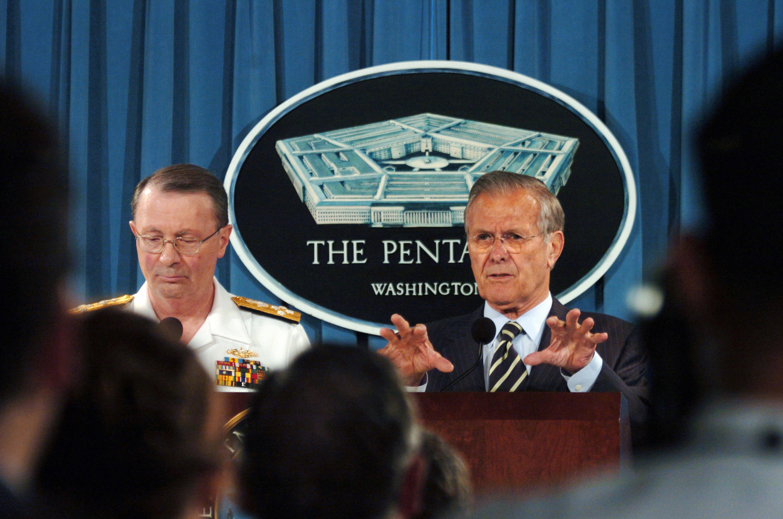 U.S. Navy Adm. Edmund Giambastiani (left), Vice-Chairman of the Joint Chiefs of STAFF, listens as The Honorable Donald H. Rumsfeld, U.S. Secretary of Defense,  answer questions from members of the media in the Pentagon press room in Washington, District of Columbia. (DoD photo by STAFF SGT. Myles Cullen) (Released)