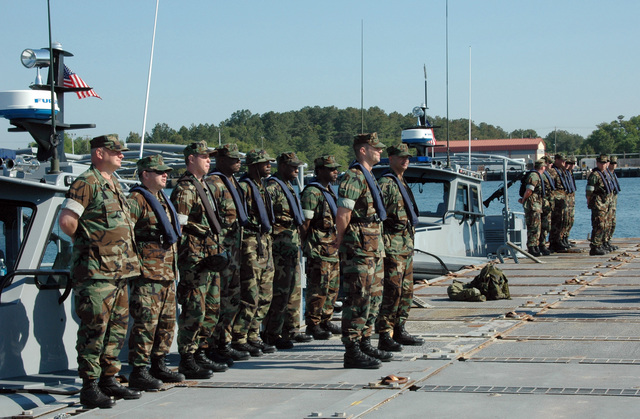 US Navy (USN) Sailors assigned to Navy Coastal Warfare Squadron 4 (NCWS-4), Inshore Boat Unit 41 (IBU-41) stand at parade rest during a pre-mission inspection at Naval Amphibious Base (NAB) Little Creek, Virginia (VA). NCWS-4 primary mission is conducting anti-terrorism and force protection in harbors and coastal waterways overseas