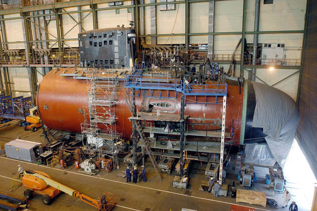 060511-N-7434T-001  (May 11, 2006)The forward section and sail unit of US Navy (USN) Virginia Class Submarine Pre-Commissioning Unit (PCU) NORTH CAROLINA (SSN 777), under construction at Northrop Grumman Newport News Shipyard, Virginia (VA). NORTH CAROLINA is the fourth Virginia-Class submarine and it is scheduled to join the fleet in 2008.U.S. Navy photo by Chris Oxley, courtesy of Northrop Grumman Ship Building (RELEASED)