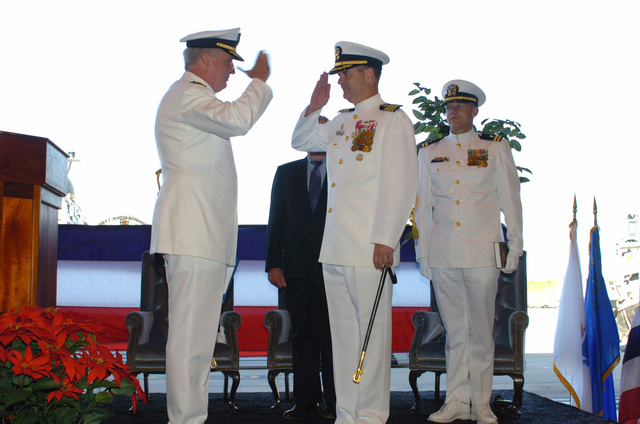 US Navy (USN) Rear Admiral (RADM) Garry E. Hall (left), Commander, Amphibious Group 2 (AG-2), salutes USN Captain (CAPT) Antony O. Heimer, Out-Going Commander, Naval Beach Group 2 (NBG-2), after presenting him with the Legion of Merit Award during the Units Change of Command Ceremony held at Naval Base Norfolk, Virginia (VA). During the Ceremony CAPT Heimer relinquished his command to USN CAPT Douglas W. Keiler