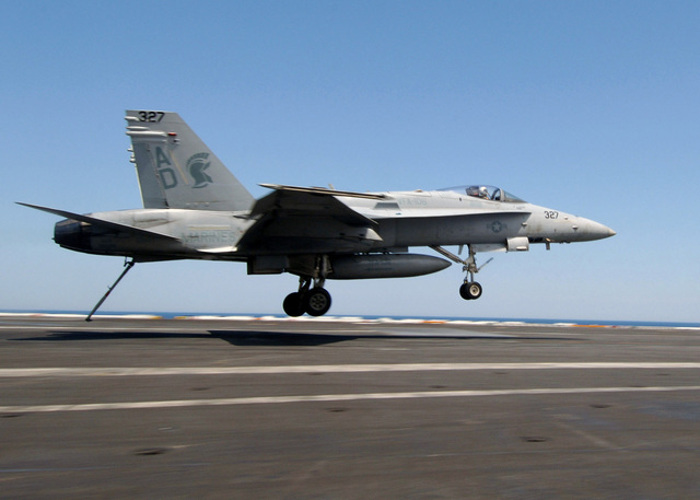 "A US Navy (USN) F/A-18C Hornet aircraft assigned to the ""Gladiators"" of Fighter Attack Squadron 106 (VFA-106) makes an arrested landing aboard USN Nimitz Class Aircraft Carrier, USS THEODORE ROOSEVELT (CVN 71). The ROOSEVELT is currently underway in the Atlantic Ocean maintaining qualifications as part of the Navy's Fleet Response Plan"