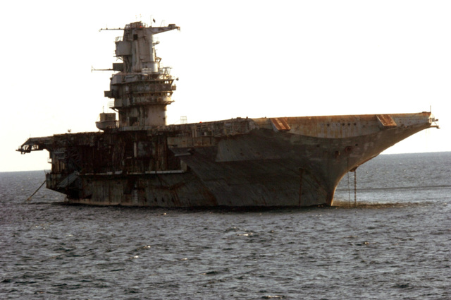 A starboard bow view of the Decommissioned US Navy (USN) Intrepid Class Aircraft Carrier USS ORISKANY (CV 34), resting at anchor after arriving at its final destination 22-miles south of Pensacola, Florida (FL) in approximately 212-ft. of water in the Gulf of Mexico, where it will become the largest ship ever intentionally sunk as an artificial reef. After ORISKANY reaches the bottom, ownership of the vessel will transfer from the USN to the State of Florida
