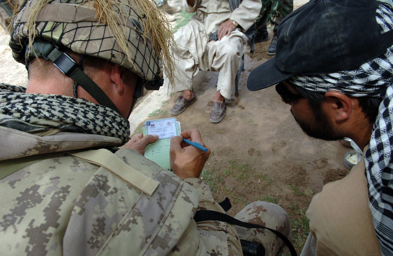 Canadian Forces SGT. Mark Janek (left), a Soldier with the 1ST Battalion, Princess Patricia's Canadian Light Infantry (PPCLI), takes notes while he and an interpreter, Ghulam Qadir Barak (right), attend refresher training course for the border patrol police on May 16, 2006, at Kandahar Air Field, Afghanistan, sponsored by the Canadian Military Police, Mobile Training Team (MTT). (U.S. Army photo by SGT. Andre Reynolds) (Released)