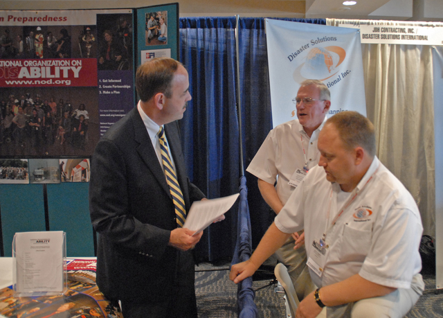 "[Hurricane Katrina] New Orleans, LA, 5-16-06 -- George Foresman, Department of Homeland Security, first Undersecretary for Preparedness, converses with Daniel Fivecoat and Joe Napier with ""JDH"" on ways to better prepare for disasters at the DHS booth at the ""Restoration 2006 Conference Trade Show"" held at the New Orleans Sheraton Hotel.  Mr. Foresman spoke at the first of its kind conference providing local governments with the tools and know-how to better prepare and recover more quickly from disasters.  Marvin Nauman/FEMA photo"