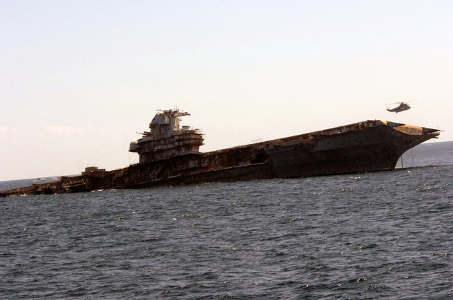 A starboard bow view showing the Decommissioned US Navy (USN) Intrepid Class Aircraft Carrier USS ORISKANY (CV 34) sinking to the ocean floor, 22-miles south of Pensacola, Florida (FL) in approximately 212-ft. of water in the Gulf of Mexico, becoming the largest ship ever intentionally sunk as an artificial reef. After ORISKANY reaches the bottom, ownership of the vessel will transfer from the USN to the State of Florida