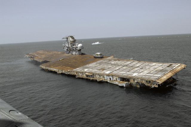 A starboard bow view showing the Decommissioned US Navy (USN) Intrepid Class Aircraft Carrier USS ORISKANY (CV 34) sinking. The carrier will rest on the sea floor 22-miles south of Pensacola, Florida (FL) in approximately 212-ft. of water in the Gulf of Mexico, becoming the largest ship ever intentionally sunk as an artificial reef. After ORISKANY reaches the bottom, ownership of the vessel will transfer from the USN to the State of Florida