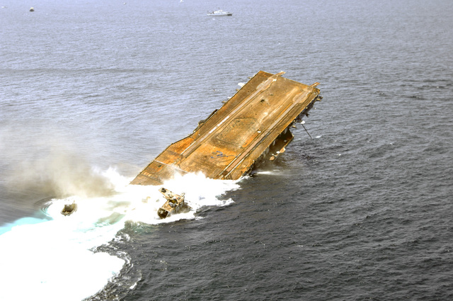 Aerial starboard side stern view showing the Decommissioned US Navy (USN) Intrepid Class Aircraft Carrier USS ORISKANY (CV 34) sinking. The carrier will rest on the sea floor 22-miles south of Pensacola, Florida (FL) in approximately 212-ft. of water in the Gulf of Mexico, becoming the largest ship ever intentionally sunk as an artificial reef. After ORISKANY reaches the bottom, ownership of the vessel will transfer from the USN to the State of Florida