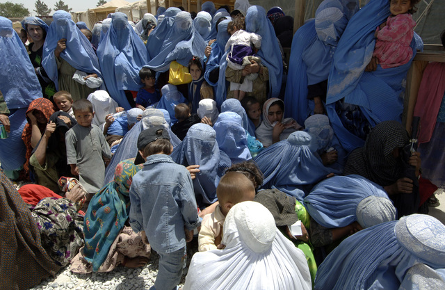 The crowd of Afghan women and children await the access to donations during a Humanitarian Civic Aid at the Egyptian Hospital. (U.S. Army photo by SPC. Leslie Angulo) (Released)