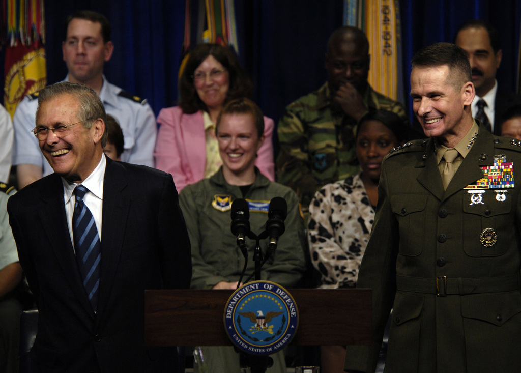 The Honorable Donald H. Rumsfeld (left), U.S. Secretary of Defense, and U.S. Marine Corps GEN. Peter Pace (right), Chairman of the Joint Chiefs of STAFF, address questions from service members and DOD civilians, during a town hall meeting at the Pentagon, Washington, D.C., on May 19, 2006. (DoD photo by STAFF SGT. Myles D. Cullen) (Released)