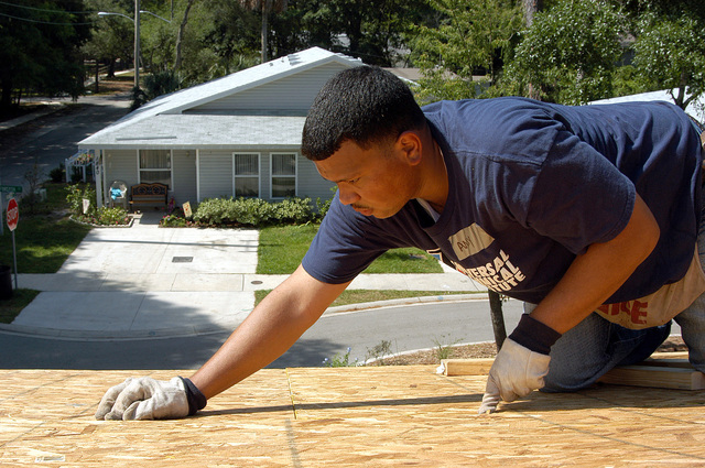 US Navy (USN) AIRMAN (AN) Daniel Akinduro assigned to the USN Nimitz Class Aircraft Carrier USS JOHN F. KENNEDY (CV 67), works on a roof top during a community relations project for the local Habitat for Humanity chapter in Atlantic Beach, Florida (FL)