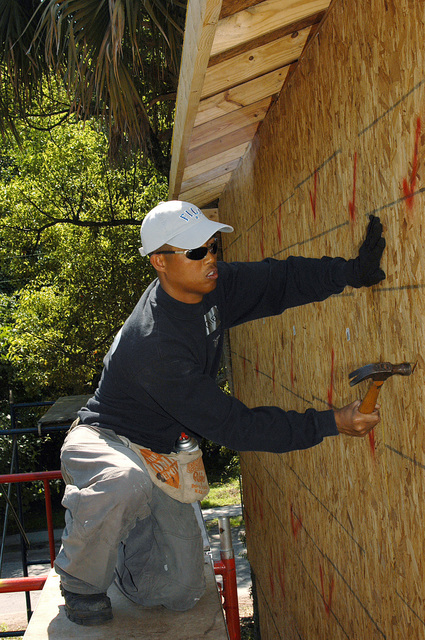 US Navy (USN) CHIEF Religious Program SPECIALIST (RPC) Fermin Ancho, helps construct a house during a community relations project for the local Habitat for Humanity chapter in Atlantic Beach, Florida (FL)