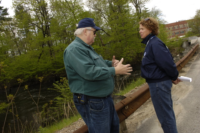 [Severe Storms and Flooding] Lebanon, ME, May 20, 2006 -- York County Emergency Manager Tom Cravens, left speaks to Dorothy Hamory who is with the Federal Emergency Management Agency preliminary damage assessment team.  Damage assessments were being done in areas to determine if federal assistance will be available to residents.  Jocelyn Augustino/FEMA