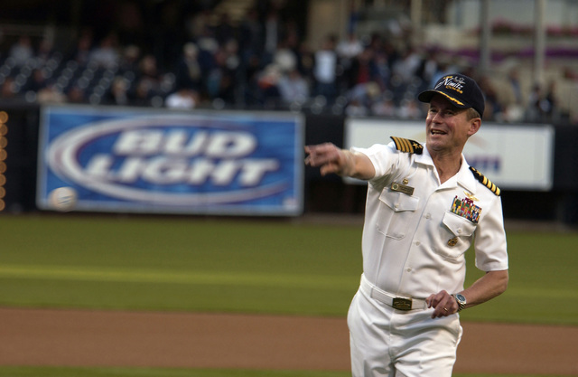 US Navy (USN) Captain (CAPT) Ted Branch, Commanding Officer (CO) of the USN Aircraft Carrier USS NIMITZ (CVN 68), throws out the ceremonial first pitch prior to a Major League Baseball (MLB) game between the San Diego Padres and Atlanta Braves at PETCO Park, San Diego, California (CA). The Padres honored Sailors from the NIMITZ in recognition of Armed Forces Appreciation Day