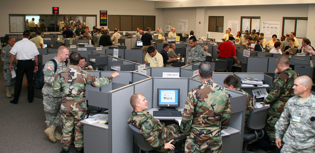 [Hurricane Katrina/Hurricane Rita] Baton Rouge, LA, May 24, 2006 -- Activity on the main floor at the Louisiana State Emergency Operations Center in Baton Rouge. Emergency support factions engage in a 2 day, full-scale exercise to simulate the pre and post landfall of a hurricane.  FEMA is funding this exercise with the intent of testing recently revised emergency procedures as local, state, federal and private entities participate to reveal the strengths and weaknesses of these plans in preparation for the 2006 hurricane season.  Robert Kaufmann/FEMA