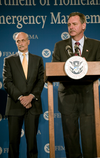 Washington D.C., 5/23/2006 -- FEMA Acting Director, David Paulison (right) and U.S.  Dept. of Homeland Security, Michael Chertoff (left) address media questions following a hurricane preparedness briefing at FEMA headquarters.  Andrea Booher/FEMA