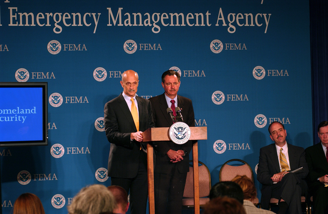 Washington, DC, May 23, 2006 -- Acting FEMA Director David Paulison and the Secretary of the Deparment of Homeland Security, Michael Chertoff field questions from reporters at a press briefing at FEMA Headquarters while Under Secretary for Preparedness George Foresman looks on.  FEMA/Bill Koplitz