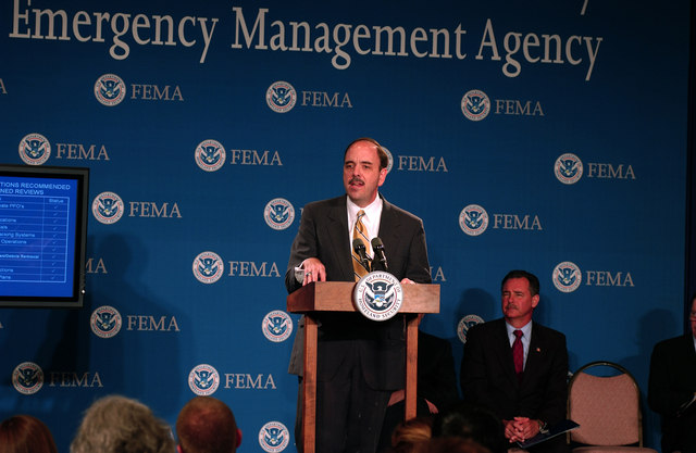 Washington, DC, May 23, 2006 -- Under Secretary for Preparedness George Foresman outlines the status of the White House recommended changes to the emergency management system while Acting FEMA Director David Paulison looks on.  Both men are participating in a press briefing on preparations for the 2006 hurricane season at FEMA Headquarters.  FEMA/Bill Koplitz