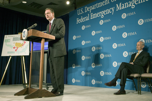 Washington D.C., 5/23/2006 -- FEMA Acting Director, David Paulison (left) answers media questions following a hurricane preparedness briefing at FEMA headquarters, behind him is U.S. Dept. of Homeland Security, Michael Chertoff.  Andrea Booher/FEMA