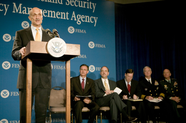 Washington D.C., 5/23/2006 -- U.S.  Dept. of Homeland Security, Michael Chertoff (podium) addresses media questions following a hurricane preparedness briefing at FEMA headquarters.  Behind him, seated (l-r): Acting FEMA Director David Paulison, Under Secretary for Preparedness George Foresman, Assistant Secretary of Defense Paul McHale, Admiral Timothy Keating and Lt. General Steven Blum. The event is one of several during Hurricane Awareness Week.  Andrea Booher/FEMA