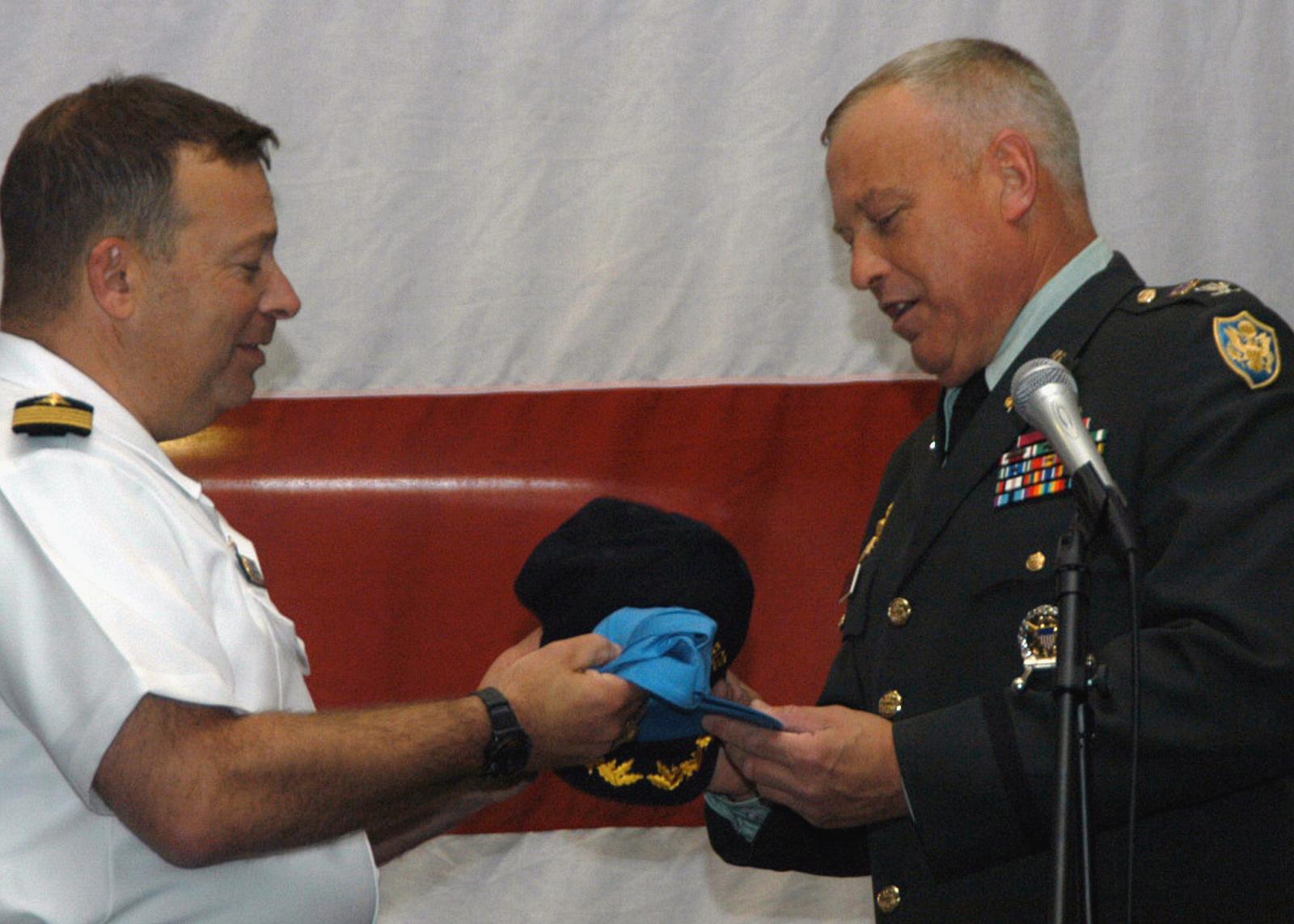 US Navy (USN) Captain (CAPT) Joseph Sensi (left), Commanding Officer