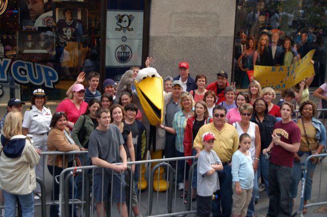 EQ Pelican (center), the US Navy (USN) Environmental Quality Mascot, a part of the USN exhibit at Pier 88 in Manhattan, greets passers-by outside the CBS studios in Rockefeller Center, New York (NY), during Fleet Week New York 2006 activities. Fleet week activities include dozens of military demonstrations and displays throughout the week, as well as public visitation to many of the participating ships