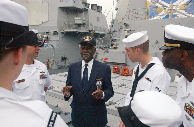 Mr. Lorenzo Dufau (center), a World War Two (WW II) Signalman who served aboard the US Navy (USN) Destroyer, USS MASON (DE-529) talks to USN Sailors from the present day USN Arleigh Burke Class (Flight IIA): Destroyer (Aegis), USS MASON (DDG 87), in New York City during Fleet Week New York 2006 activities.Mr. Dufau was a member of the MASON during World War II, which was the first navy ship predominantly manned by black crewmembers. Fleet Week includes dozens of military demonstrations and displays throughout the week, as well as public visitation to many of the participating ships. (SUBSTANDARD)