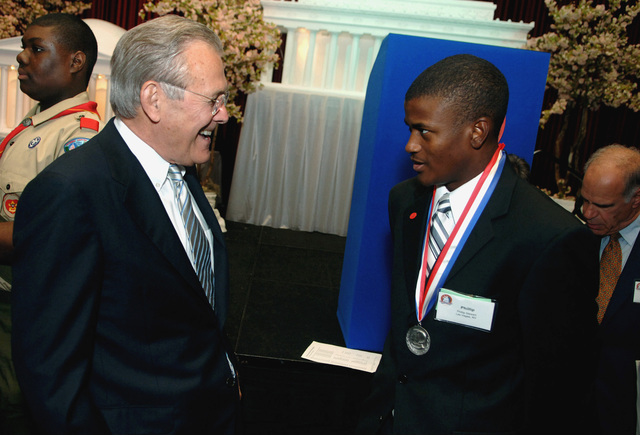 The Honorable Donald H. Rumsfeld (left), U.S. Secretary of Defense, speaks with Eagle Scout Phillip D. Stewart (right), winner of the Young American Award, and a U.S. Marine Corps Marine, during the Golden Buffalo Awards at the Marriott Wardman Park, Washington, D.C., on May 25, 2006. (DoD photo by PETTY Officer 1ST Class Chad J. McNeeley) (Released)