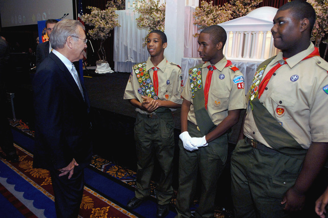 The Honorable Donald H. Rumsfeld (left), U.S. Secretary of Defense, speaks with local Maryland Boy Scouts prior to receiving the Golden Buffalo Award, the Boy Scouts highest commendation, during the national annual Boy Scout meeting at the Marriott Wardman Park, Washington, D.C., on May 25, 2006. (DoD photo by PETTY Officer 1ST Class Chad J. McNeeley) (Released)