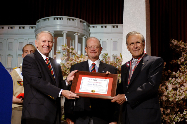 The Honorable Donald H. Rumsfeld (right), U.S. Secretary of Defense, receives the Golden Buffalo Award, the Boy Scouts highest commendation, from Roy L. Williams, CHIEF Scout Executive (left), and John C. Cushman III (right), National President of the Boy Scouts of America, during the national annual meeting of the Boy Scouts at the Marriott Wardman Park, Washington, D.C., on May 26, 2006. (DoD photo by PETTY Officer 1ST Class Chad J. McNeeley) (Released)