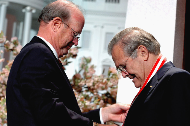 The Honorable Donald H. Rumsfeld (right), U.S. Secretary of Defense, receives the Golden Buffalo Award, the Boy Scouts highest commendation, from the National President of the Boy Scouts of America, John C. Cushman (left), during the national annual meeting of the Boy Scouts at the Marriott Wardman Park, Washington, D.C., on May 26, 2006. (DoD photo by PETTY Officer 1ST Class Chad J. McNeeley) (Released)