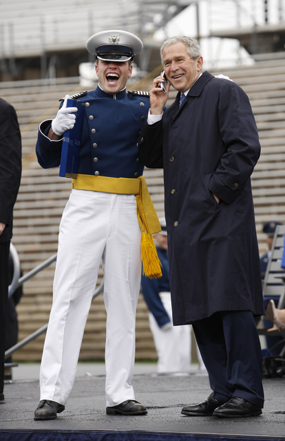 President George W. Bush Shares a Phone Conversation with a Graduate of the United States Air Force Academy during Commencement Ceremonies in Colorado Springs