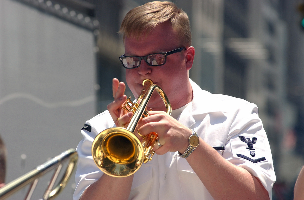 US Navy (USN) Musician Third Class (MU3) Josh Sullins, a member of the USN Show Band of the Northeast performs a trumpet solo in Times Square during Fleet Week New York 2006. Fleet Week includes dozens of military demonstrations and displays, including public tours to many of the participating ships