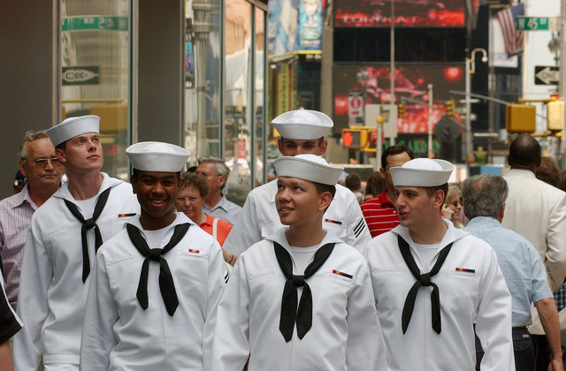 "US Navy (USN) Sailors tour the""Big Apple""and enjoy a lighter moment while walking in Times Square during Fleet Week New York 2006. Fleet Week includes dozens of military demonstrations and displays, including public tours to many of the participating ships"
