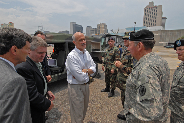[Hurricane Katrina] New Orleans, LA, 05-30-06 -- Secretary of the US Department of Homeland Security, Michael Chertoff, and FEMA Deputy Director of Gulf Coast Recovery, Gil Jamieson, are briefed on the Army's rapid deployment of mobil communications systems.  Marvin Nauman/FEMA photo