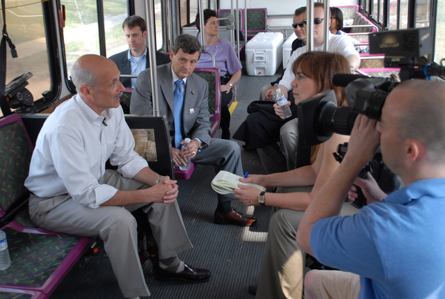 [Hurricane Katrina] New Orleans, LA, 05-30-06 -- Secretary of the US Department of Homeland Security, Michael Chertoff, is interviewed by CNN about hurricane preparedness.  The group is sitting in one of the Busses used to evacuate hurricane Katrina victims.  Marvin Nauman/FEMA photo