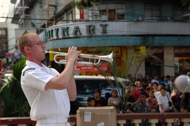 US Navy (USN) PETTY Officer Third Class (PO3) Jaime Kaufman a member of the USN Show Band, from the Military Sealift Command (MSC), Hospital Ship, USNS MERCY (T-AH 19), performs a trumpet solo during a performance in Zamboanga, Republic of the Philippines. This is one of the many services offered by the USNS MERCY during its five-month humanitarian deployment to South Asia, Southeast Asia and the Pacific Islands