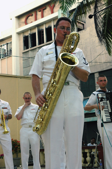 US Navy (USN) PETTY Officer Third Class (PO3) Kelly Dacosta, a member of the USN Show Band, from the Military Sealift Command (MSC), Hospital Ship, USNS MERCY (T-AH 19), performs a saxophone solo during a performance in Zamboanga, Republic of the Philippines. This is one of the many services offered by the USNS MERCY during its five-month humanitarian deployment to South Asia, Southeast Asia and the Pacific Islands