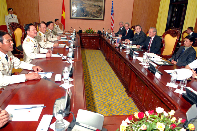 The Honorable Donald H. Rumsfeld (2nd from right), U.S. Secretary of Defense, and GEN. Pham Van Tra (3rd from left), Minister of Defense of Vietnam, discuss mutual defense issues in Hanoi, Vietnam, on Jun. 5, 2006. (DoD photo by PETTY Officer 1ST Class Chad J. McNeeley) (Released)