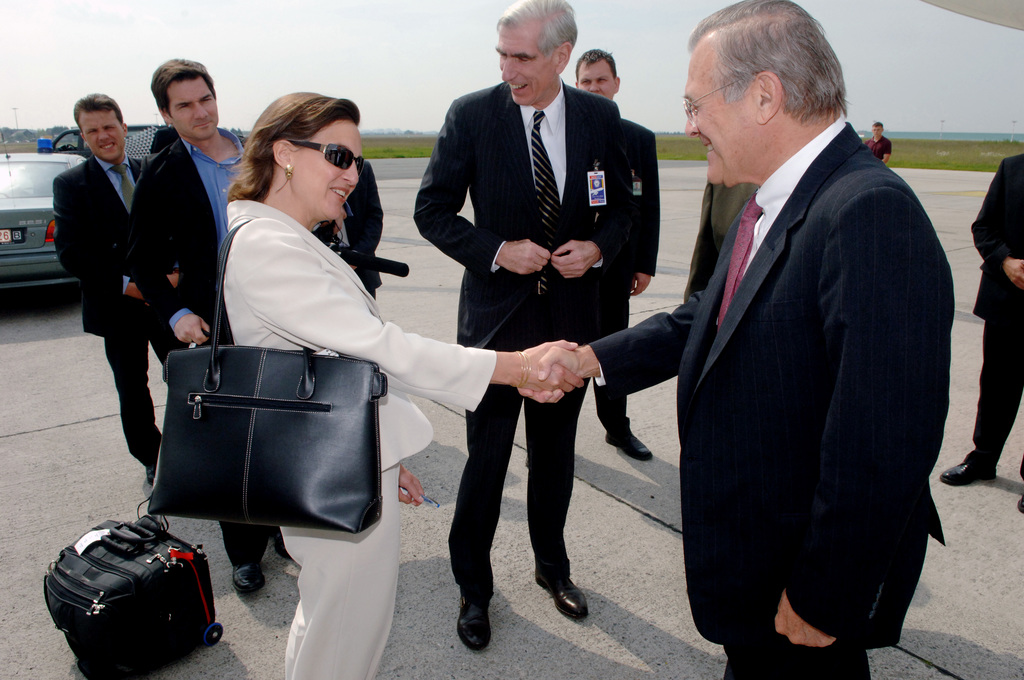 The Honorable Donald H. Rumsfeld (right), U.S. Secretary of Defense, is greeted by Victoria Nuland (left), U.S. Ambassador to NATO, in Brussels, Belgium, on Jun. 7, 2006.  (DoD photo by PETTY Officer 1ST Class Chad J. McNeeley) (Released)