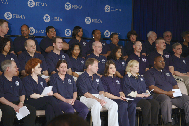 Washington, DC, June 8, 2006 -- FEMA employees wait behind the podium for R. David Paulison to be sworn in as the Director of FEMA at FEMA headquarters.  FEMA/Bill Koplitz