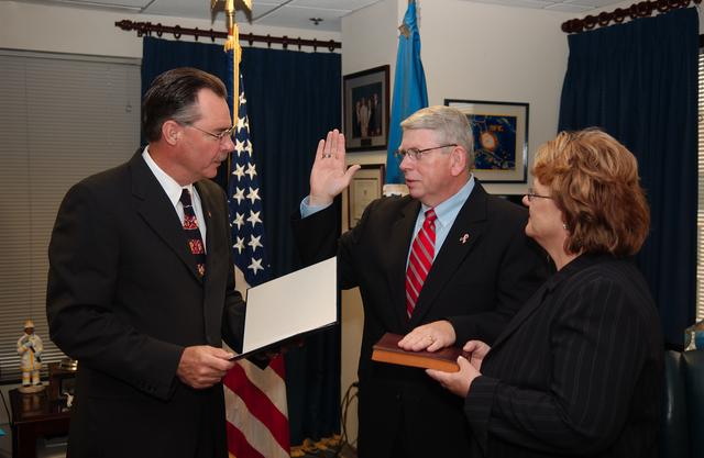 Washington, DC, June 12, 2006 -- R. David Paulison, the Director of FEMA, swears in Glenn Cannon as Director of Response for FEMA.  Holding the bible is Mrs. Cannon.  FEMA/Bill Koplitz