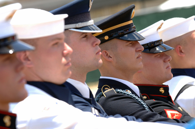 US Military personnel, who serve as the Pentagon Joint Service Honor Guard, present the Colors at the ginning of the ground breaking ceremony that marks the start of the construction of the Memorial that will honor the 184 lives lost when terrorists hijackers caused American Airlines Flight 77 to crash into the Pentagon on Septemr 11, 2001. Each of the 184 memorial units at the Memorial will consist of a cantilevered nch placed over reflecting pool. 59 memorial units, representing the Pentagon employees who died, will face one direction and the other 125 memorial units, representing the 125 who died onboard Flight 77, will face the other direction. Finally, 80 Paperbark Trees will...