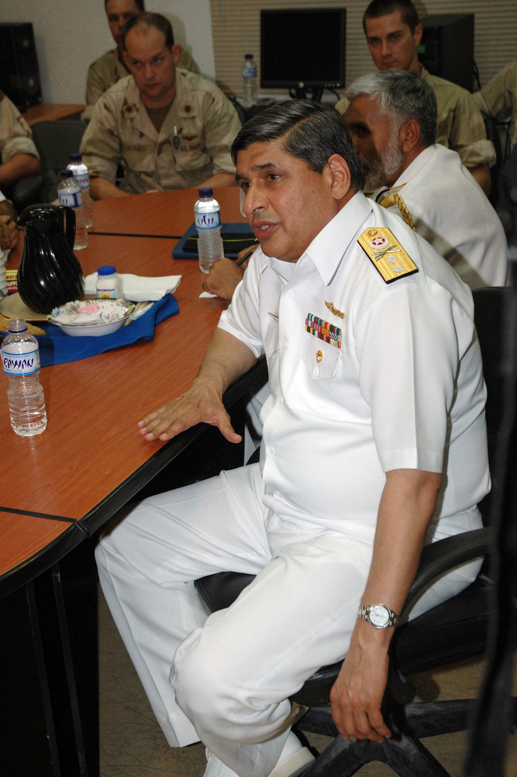 Pakistan Navy Rear Admiral (RADM) Shahid Iqbal, Commander, Task Force 150 (CTF-150), speaks with US Navy (USN) Sailors assigned to Patrol Squadron 9 (VP-9), during his visit at Al Udeid Air Base (AB), Qatar. RADM Iqbal is visiting to learn more about the operation and maintenance of the P-3C Orion asset. VP-9 is currently on deployment to both 5th and 7th Fleet Areas of Operation (AOR), conducting reconnaissance and maritime patrol operations supporting Operation IRAQI FREEDOM and Operation ENDURING FREEDOM