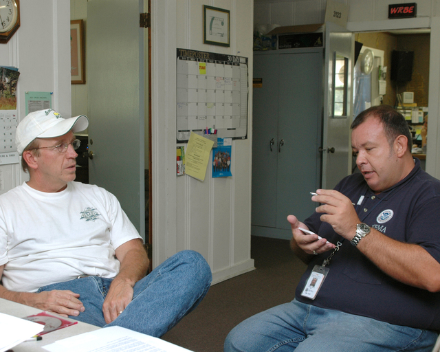 [Hurricane Katrina] Lucedale, Miss., June 21, 2006 -- A Federal Emergency Mangement Agency (FEMA) Public Information Officer, Pete Garcia, talks with Larry Shirley, owner and general manager of radio station WRBE.  Michelle Miller-Freeck/FEMA
